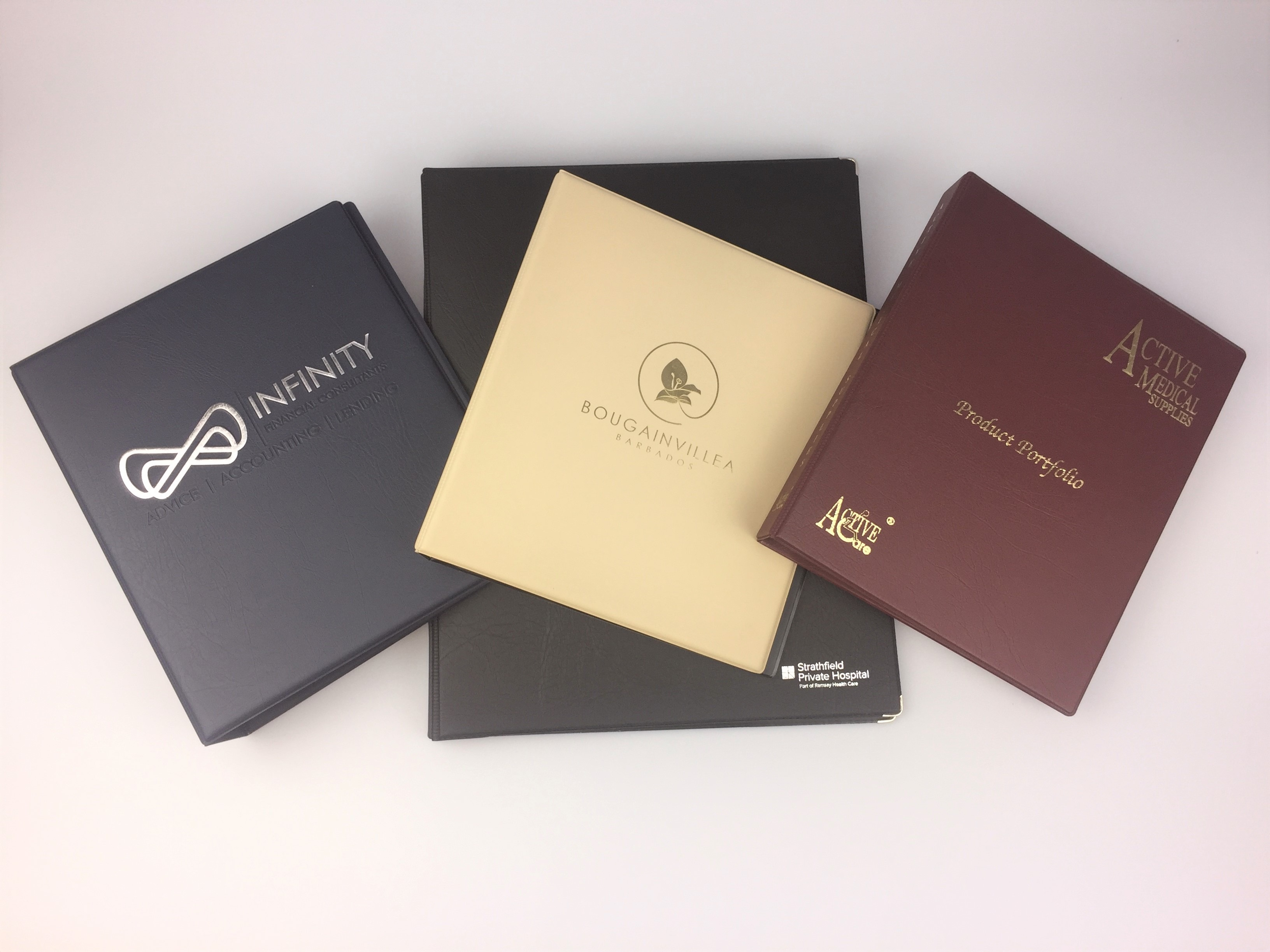 Corporate Branding Specialist Plastics Unique makes a wide range of branded stationery including these ring binders in a wide range of colours, fabrics. and prints